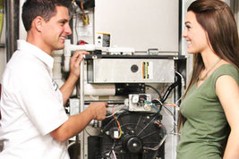 Man and woman talking near a central air and heating unit in a commercial property.